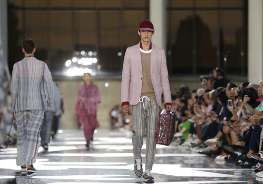 (AP Photo/Luca Bruno, File). FILE-  In this Friday, June 15, 2018 file photo, a model wears a creation part of the Ermenegildo Zegna men's Spring-Summer 2019 collection, that was presented in Milan, Italy. Italian fashion houses are refashioning themse...