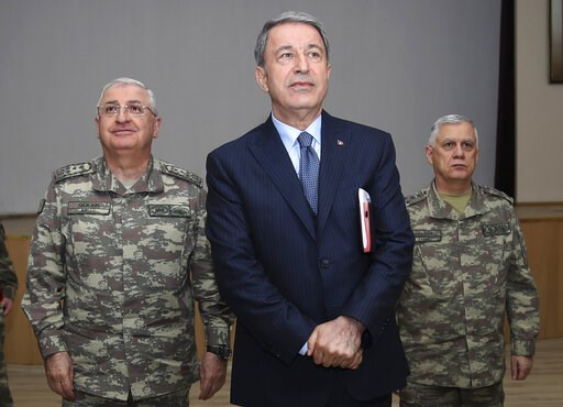 (Turkish Defence Ministry via AP). Turkey's Defence Minister Hulusi Akar listens during a meeting with the commanders of military units on Syrian border in Sanliurfa, southeastern Turkey, Friday, Jan. 11, 2019. Akar on an unannounced visit to troops st...