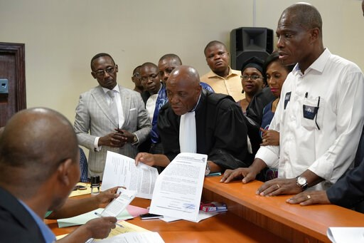 (AP Photo/Jerome Delay). Accompanied by his wife and his lawyers, spurned Congo opposition candidate Martin Fayulu, right, petitions the constitutional court following his loss in the presidential elections in Kinshasa, Congo, Saturday Jan. 12, 2019. T...