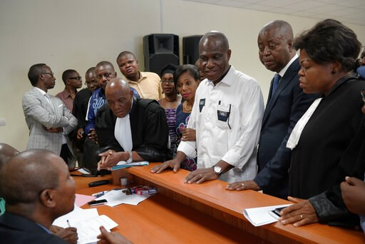 (AP Photo/Jerome Delay). Accompanied by his wife and his lawyers, Congo opposition candidate Martin Fayulu, center, petitions the constitutional court following his loss in the presidential elections in Kinshasa, Congo, Saturday Jan. 12, 2019. The ruli...