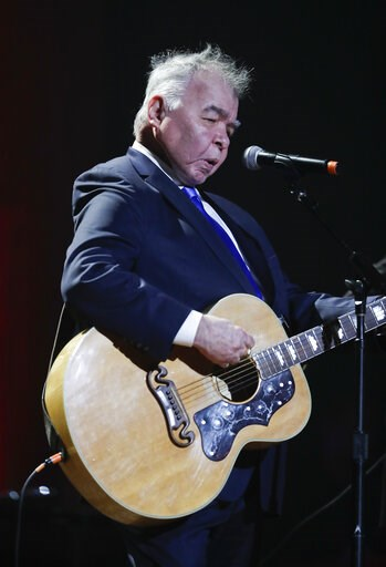 (AP Photo/Mark Zaleski, File). FILE - In this Wednesday, Sept. 13, 2017 file photo, John Prine performs during the Americana Honors and Awards show in Nashville, Tenn. Missy Elliott is making history as the first female rapper inducted into the Songwri...