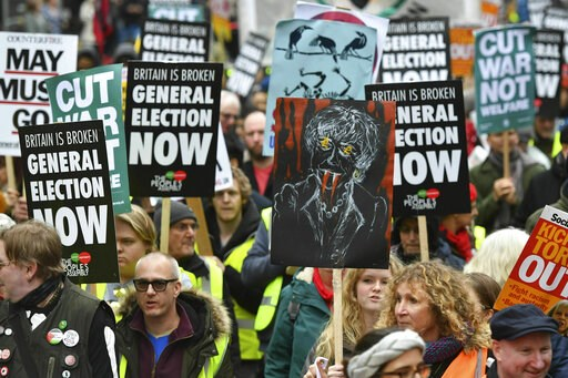 (Dominic Lipinski/PA via AP). People's Assembly Against Austerity stage a  rally in central London calling for a general election. Saturday Jan. 12, 2019. Hundreds of protesters inspired by France's so-called 'yellow vest' movement are rallying in Brit...