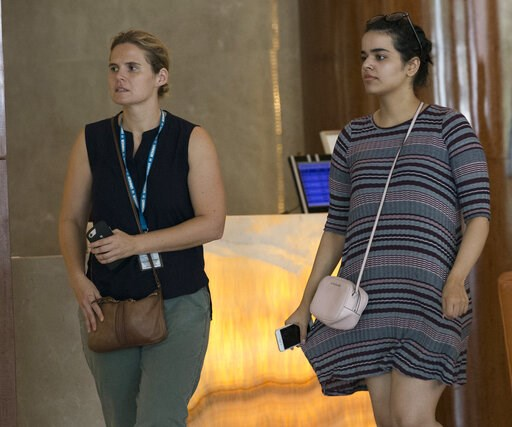 (AP Photo/Sakchai Lalit). Rahaf Mohammed Alqunun, right, walks with an unidentified companion in Bangkok, Thailand, Friday, Jan. 11, 2019. Alqunun, the 18-year old Saudi woman who fled her family to seek asylum, remains in Thailand under the care of th...