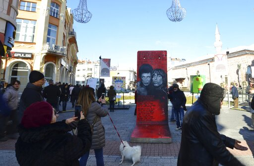(AP Photo/STR). People take pictures of exhibits at the Art Liberte exhibition, the first traveling exhibition to mark the 30 years anniversary of fall of the Berlin wall in the town of Plovdiv ahead of the opening ceremony of Plovdiv as one of Europea...