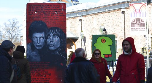 (AP Photo/STR). People look at exhibits at the Art Liberte  the first traveling exhibition marking the 30 years anniversary of fall of the Berlin wall in the town of Plovdiv ahead of the opening ceremony of Plovdiv as one of European Capital of Culture...