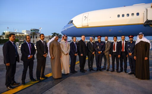 (Andrew Caballero-Reynolds/Pool Photo via AP). U.S. Secretary of State Mike Pompeo, center, poses with his local security team before departing Manama International Airport in Manama, Bahrain, Friday, Jan. 11, 2019.