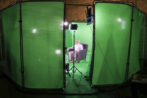 (McGuire Boles/Dallas Holocaust Museum via AP). This August 2018 photo shows Holocaust survivor Max Glauben sitting in an interactive green screen room while filming a piece for the Dallas Holocaust Museum in Dallas. Glauben will be the latest to have ...