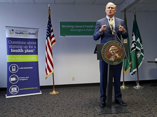 (AP Photo/Ted S. Warren, File). FILE - In this Tuesday, Jan. 8, 2019, file photo, Washington Gov. Jay Inslee answers questions from reporters at a news conference in Seattle. Gov. Inslee proposed a public health insurance option for people who are not ...
