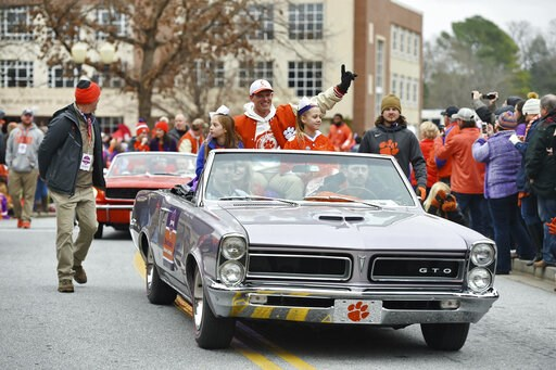 (AP Photo/Richard Shiro). Defensive head coach Brent Venables, along with family members ride in the parade honoring Clemson Saturday, Jan. 12, 2019, in Clemson, S.C.,  The Tigers defeated Alabama 44-16 in the College Football Playoff championship game...