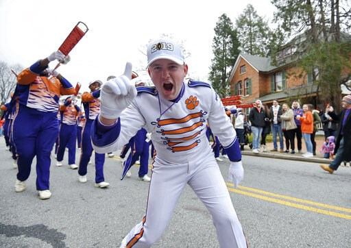 (AP Photo/Richard Shiro). A Clemson band member shows his excitement during a parade honoring Clemson Saturday, Jan. 12, 2019, in Clemson, S.C., The Tigers defeated Alabama 44-16 in the College Football Playoff championship game Monday Jan. 7.