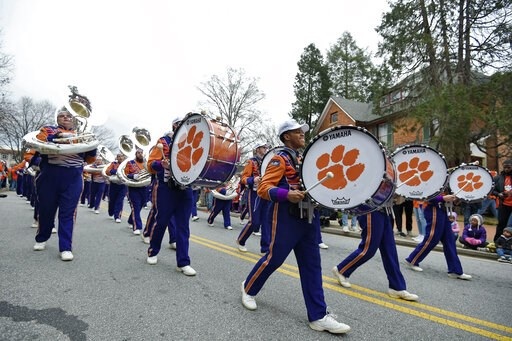 (AP Photo/Richard Shiro). A band marches down the street during a parade honoring the Clemson Tigers, Saturday, Jan. 12, 2019, in Clemson, S.C.,  Clemson defeated Alabama 44-16 in the College Football Playoff championship game Monday Jan. 7.