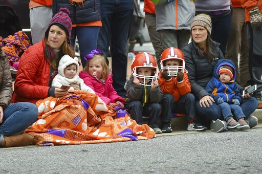 (AP Photo/Richard Shiro). A family enjoys  the parade held in Clemson's honor Saturday, Jan. 12, 2019, in Clemson, S.C.,  TheTigers defeated Alabama 44-16 in the College Football Playoff championship game Monday Jan. 7.