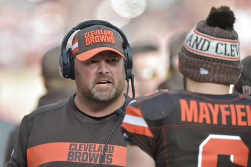 (AP Photo/David Richard, File). FILE - In this Nov. 4, 2018, file photo, Cleveland Browns offensive coordinator Freddie Kitchens talks to quarterback Baker Mayfield during an NFL football game against the Kansas City Chiefs, in Cleveland. A person fami...