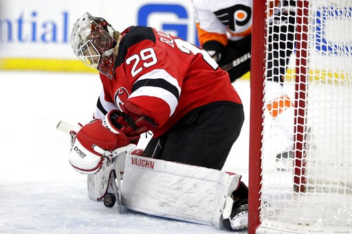 (AP Photo/Julio Cortez). New Jersey Devils goaltender MacKenzie Blackwood blocks a shot from the Philadelphia Flyers during the first period of an NHL hockey game, Saturday, Jan. 12, 2019, in Newark, N.J.