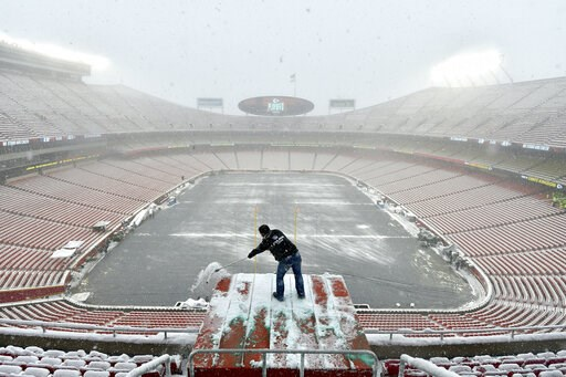 (AP Photo/Ed Zurga). Kyle Haraugh, of NFL Films, clears snow from a camera location at Arrowhead Stadium before an NFL divisional football playoff game between the Kansas City Chiefs and the Indianapolis Colts, in Kansas City, Mo., Saturday, Jan. 12, 2...