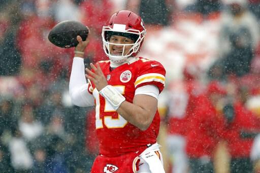 (AP Photo/Charlie Neibergall). Kansas City Chiefs quarterback Patrick Mahomes (15) warms up as snow falls before an NFL divisional football playoff game against the Indianapolis Colts in Kansas City, Mo., Saturday, Jan. 12, 2019.