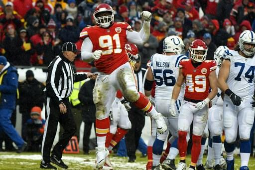 (AP Photo/Ed Zurga). Kansas City Chiefs nose tackle Derrick Nnadi (91) celebrates a tackle of Indianapolis Colts running back Marlon Mack during the first half of an NFL divisional football playoff game in Kansas City, Mo., Saturday, Jan. 12, 2019.