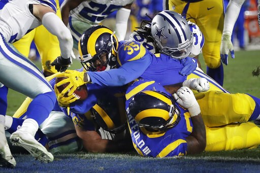 (AP Photo/Marcio Jose Sanchez). Los Angeles Rams running back C.J. Anderson scores against the Dallas Cowboys during the first half in an NFL divisional football playoff game Saturday, Jan. 12, 2019, in Los Angeles.