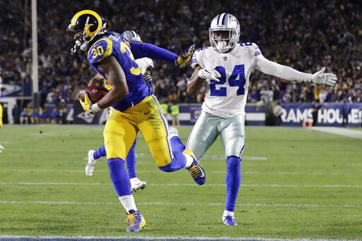 (AP Photo/Marcio Jose Sanchez). Los Angeles Rams running back Todd Gurley scores past Dallas Cowboys cornerback Chidobe Awuzie during the first half in an NFL divisional football playoff game Saturday, Jan. 12, 2019, in Los Angeles.