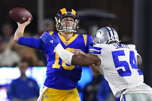 (AP Photo/Mark J. Terrill). Los Angeles Rams quarterback Jared Goff passes under pressure from Dallas Cowboys middle linebacker Jaylon Smith during the first half in an NFL divisional football playoff game Saturday, Jan. 12, 2019, in Los Angeles.