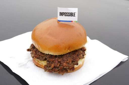 (AP Photo/Nati Harnik). The Impossible Burger, a plant-based burger containing wheat protein, coconut oil and potato protein among it's ingredients, is seen Friday, Jan. 11, 2019. The ingredients of the Impossible Burger are clearly printed on the menu...