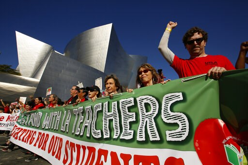 (AP Photo/Damian Dovarganes). In this Saturday, Dec. 15, 2018 photo, thousands of teachers rally against the nation's second-largest school district in downtown Los Angeles. A massive teachers strike in Los Angeles is all but inevitable starting Monday...