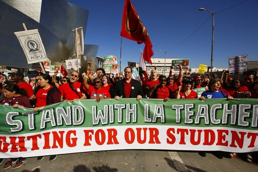 (AP Photo/Damian Dovarganes). In this Saturday, Dec. 15, 2018, photo, thousands of teachers rally against the nation's second-largest school district in downtown Los Angeles. A massive teachers strike in Los Angeles is all but inevitable starting Monda...