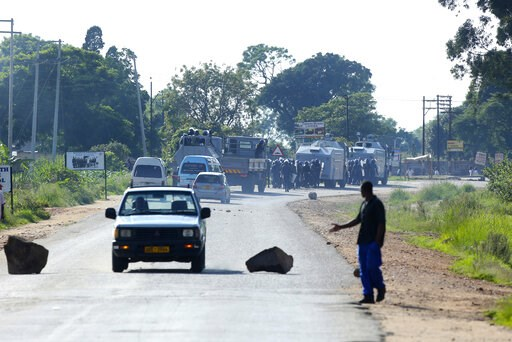 (AP Photo/Tsvangirayi Mukwazhi). Riot police are seen on the streets during protests over the hike in fuel prices in Harare, Zimbabwe, Monday, Jan. 14, 2019. In an address Saturday, Zimbabwean President Emmerson Mnangagwa more than doubled the price of...