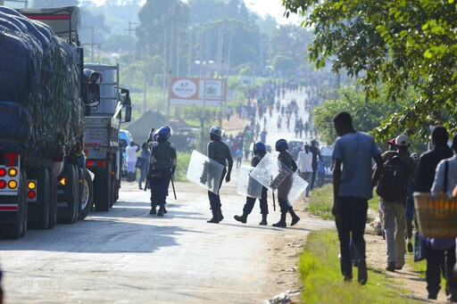 (AP Photo/Tsvangirayi Mukwazhi). Riot police are seen on a street during a demonstration over the hike in fuel prices in Harare, Zimbabwe, Monday, Jan. 14, 2019. Zimbabwean President Emmerson Mnangagwa has more than doubled the price of gasoline, hopin...