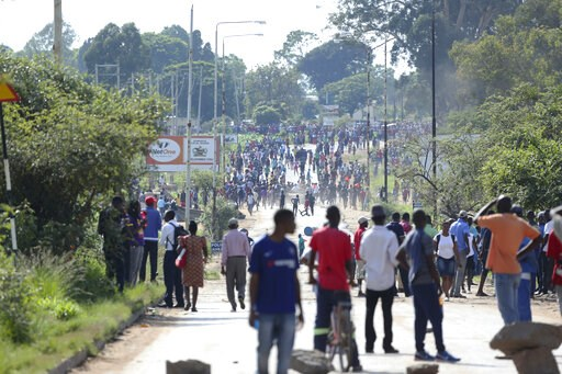 (AP Photo/Tsvangirayi Mukwazhi). Protesters gather on a street during a demonstration over the hike in fuel prices in Harare, Zimbabwe, Monday, Jan. 14, 2019. Zimbabwean President Emmerson Mnangagwa has more than doubled the price of gasoline, hoping t...