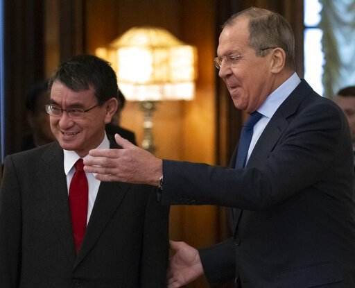 (AP Photo/Alexander Zemlianichenko). Russian Foreign Minister Sergey Lavrov, right, welcomes Japanese Foreign Minister Taro Kono for the talks in Moscow, Russia, Monday, Jan. 14, 2019.