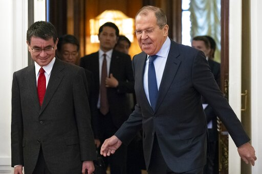 (AP Photo/Alexander Zemlianichenko). Russian Foreign Minister Sergey Lavrov, right, and Japanese Foreign Minister Taro Kono enter a hall for their talks in Moscow, Russia, Monday, Jan. 14, 2019.