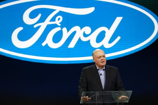 (AP Photo/Carlos Osorio, File). FILE- In this Jan. 14, 2018, file photo Ford President and CEO Jim Hackett prepares to address the media at the North American International Auto Show in Detroit. A new version of the Ford Explorer big SUV will be shown ...