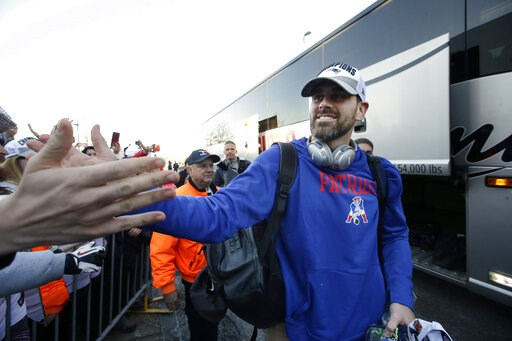 (AP Photo/Steven Senne). New England Patriots kicker Stephen Gostkowski, right, greets fans following the football teams arrival at Gillette Stadium, Monday, Feb. 4, 2019, in Foxborough, Mass., after defeating the Los Angeles Rams Sunday in NFL Super B...
