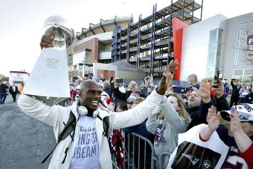 (AP Photo/Steven Senne). New England Patriots cornerback Jason McCourty, left, holds the Super Bowl trophy as he greets fans following the football team's arrival at Gillette Stadium, Monday, Feb. 4, 2019, in Foxborough, Mass, after defeating the Los A...