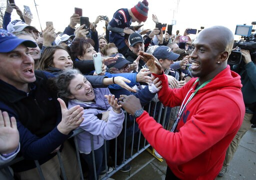 (AP Photo/Steven Senne). New England Patriots free safety Devin McCourty, right, greets fans following the football teams arrival at Gillette Stadium, Monday, Feb. 4, 2019, in Foxborough, Mass, after defeating the Los Angeles Rams Sunday in NFL Super B...