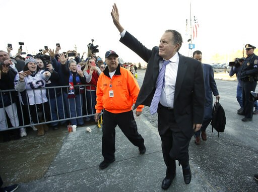 (AP Photo/Steven Senne). New England Patriots head coach Bill Belichick, center right, waves to fans following the football teams arrival at Gillette Stadium, Monday, Feb. 4, 2019, in Foxborough, Mass., after defeating the Los Angeles Rams Sunday in NF...
