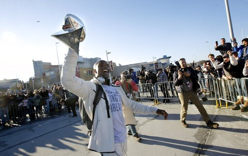 (AP Photo/Steven Senne). New England Patriots cornerback Jason McCourty holds the Super Bowl trophy for fans following the football teams arrival at Gillette Stadium, Monday, Feb. 4, 2019, in Foxborough, Mass., after defeating the Los Angeles Rams Sund...