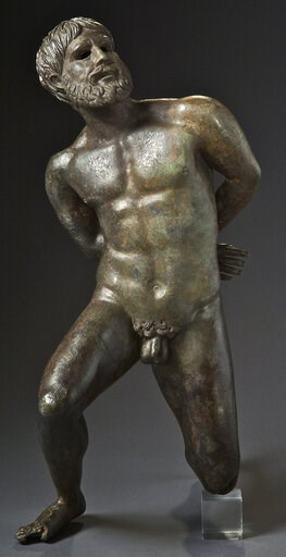 "(Jean-Luc Maby/Musee Departemental Arles Antique via AP). This image made available on Monday Feb. 4, 2019 by Musee Departemental Arles Antique shows a bronze ""Statue of a captive"" dating from the first century B.C.. A Geneva art museum said on Monday,..."