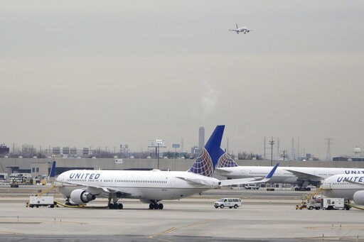 (AP Photo/Julio Cortez, File). FILE - In this Wednesday, Jan. 23, 2019 file photo, United Airlines jets are seen as a plane approaches Newark Liberty International Airport, in Newark, N.J. United Airlines will woo high-fare passengers by retrofitting m...
