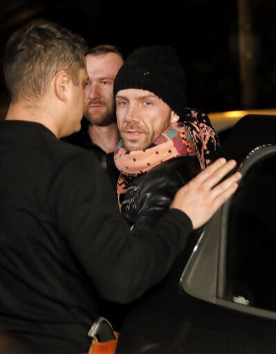 (AP Photo/Vadim Ghirda). Matteo Politi, 38, who used the alias Matthew Mode, and claimed he was British, right, is escorted by police officers in Bucharest, Romania, Wednesday, Feb. 6, 2019. Romanian border police detained Italian citizen Matteo Politi...