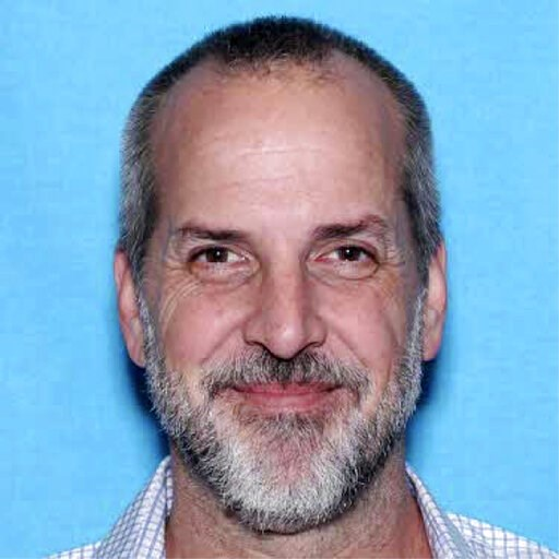 (FBI Oregon via AP). This Department of Motor Vehicles photo released by the FBI in Oregon shows Robert Arnold Koester. Authorities in Oregon say Koester, a professional photographer, has been indicted on more than 30 charges, including rape, after he ...