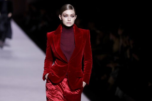 (AP Photo/Julio Cortez). Gigi Hadid models fashion from the Tom Ford collection during Fashion Week, Wednesday, Feb. 6, 2019, in New York.