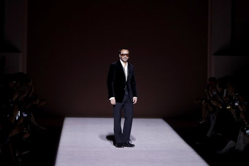 (AP Photo/Julio Cortez). Fashion designer Tom Ford appears on the runway after showing his latest collection during Fashion Week, Wednesday, Feb. 6, 2019, in New York.