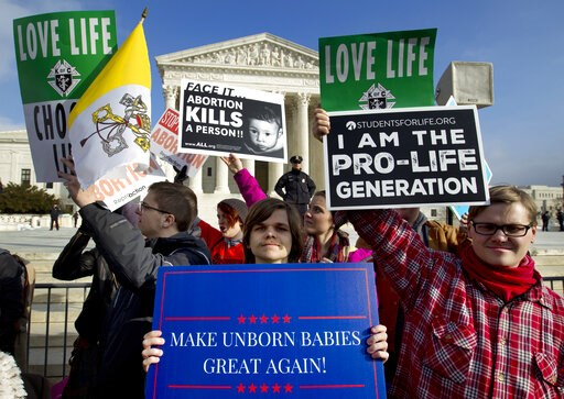 (AP Photo/Jose Luis Magana). FILE - In this Friday, Jan. 18, 2019 file photo, anti-abortion activists protest outside of the U.S. Supreme Court, during the March for Life in Washington. President Trump's call for a ban on late-term abortions is unlikel...