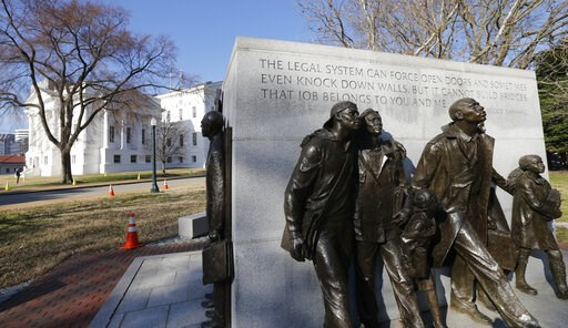 (AP Photo/Steve Helber). In this Feb. 5, 2019, photo, a statue commemorating the African-American students whose 1951 school walkout became a key moment in the civil-rights movement sits on the grounds of the Capitol in Richmond, Va. Virginia has becom...