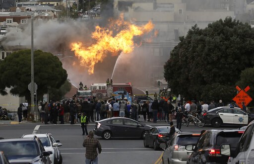 (AP Photo/Jeff Chiu). San Francisco firefighters battle a fire on Geary Boulevard in San Francisco, Wednesday, Feb. 6, 2019. A gas explosion in a San Francisco neighborhood shot flames high into the air Wednesday and was burning several buildings as ut...