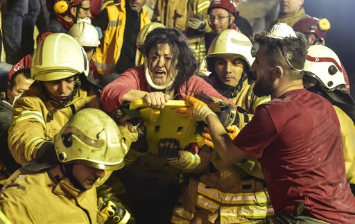 (DHA via AP). A woman reacts after rescue workers had pulled her out the rubble of an eight-story building which collapsed in Istanbul, Wednesday, Feb. 6, 2019. The eight-story building collapsed, killing at least two people and trapping several others...