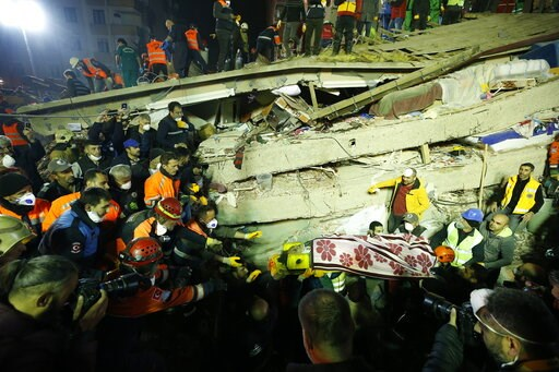 (AP Photo/ Emrah Gurel). Rescue workers carry a woman from the rubble of an eight-story building which collapsed in Istanbul, Wednesday, Feb. 6, 2019. The eight-story building collapsed, killing at least two people and trapping several others inside th...