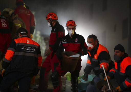(AP Photo/ Emrah Gurel). Rescue workers search for survivors at the rubble of an eight-story building which collapsed in Istanbul, late Wednesday, Feb. 6, 2019. The eight-story building collapsed, killing at least two people and trapping several others...